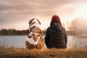 Best friends looking out over the lake