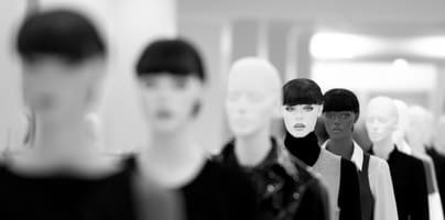 Mannequins lined up inside store