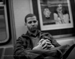 Man is resting on subway