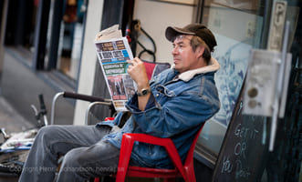 Man is reading news paper