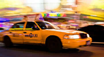 The classic yellow NYC cab, with yellow background