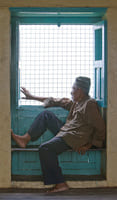 Nepalese gentleman is looking out of window
