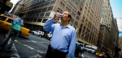 Business man drinking a Diet Coke